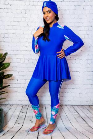 model wearing blue peplum modest swimwear burkini